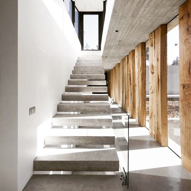 Raw timber concrete interiors interiordesign for Raw space architects