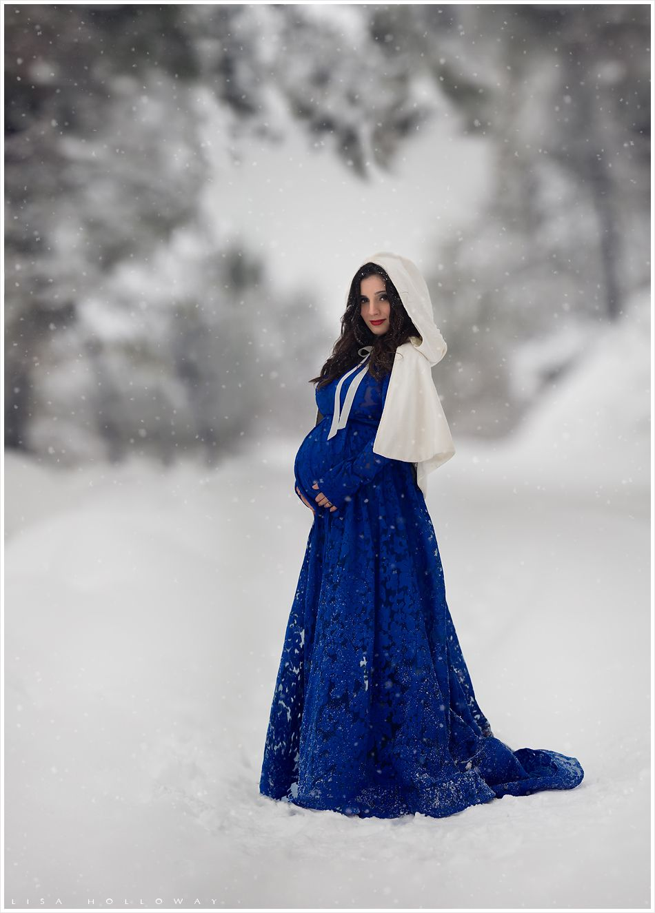 c9186b1d7b Beautiful pregnant woman with a royal blue dress and white cloak stands on  a snowy road lined with snow covered trees. LJHolloway Photography is a Las  Vegas ...
