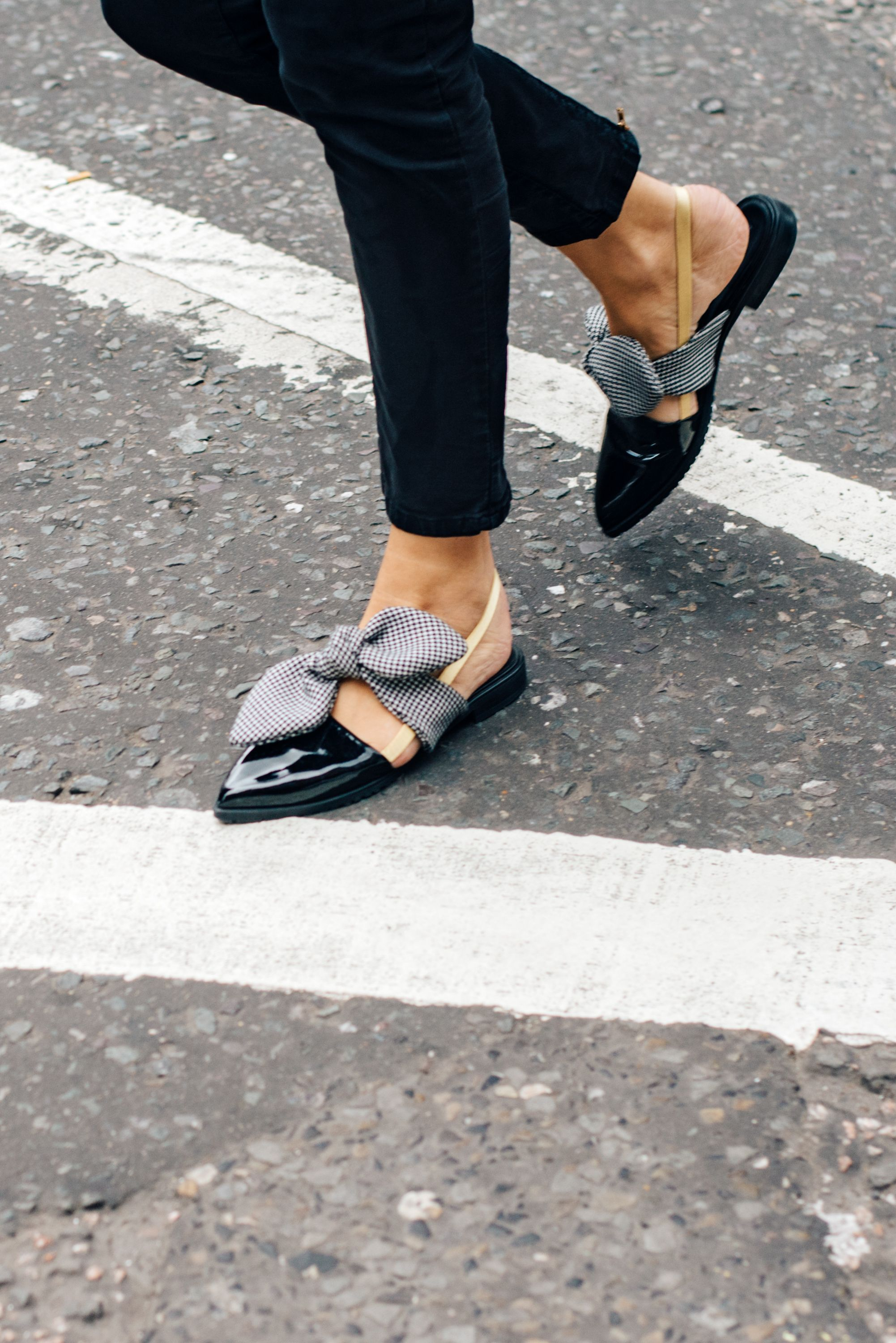 a5a01ef1359c Black pointy toe flats with bow. London Fashion Week Street Style ...