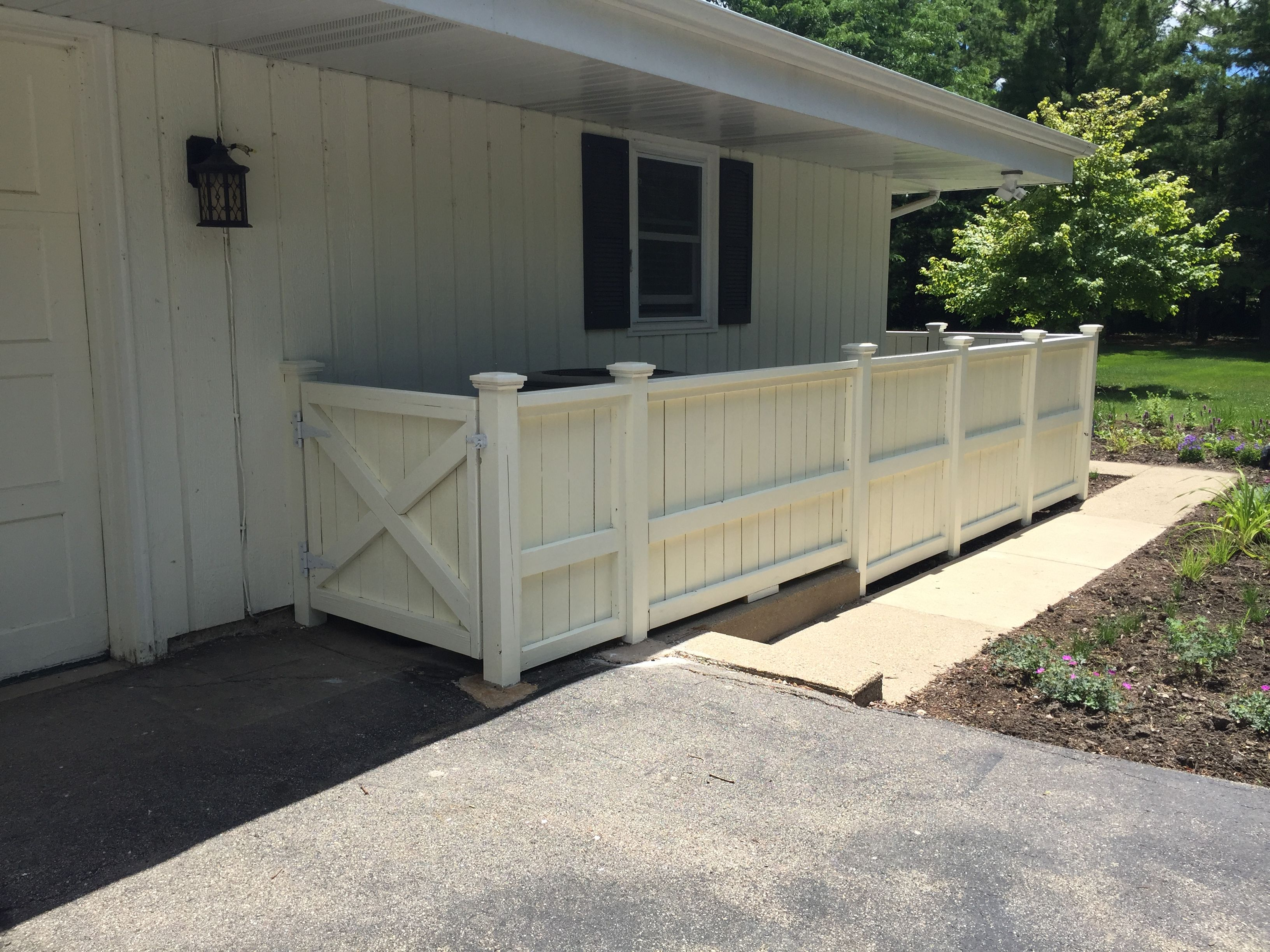 Removable Privacy Fence removable fence panels hide the waste container, air conditioner