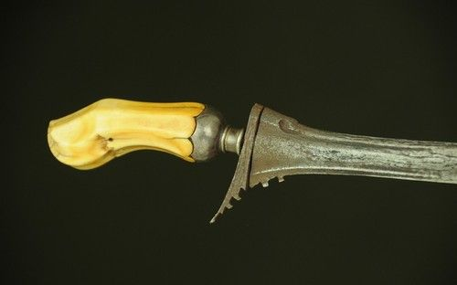 Ivory Hilted Executioner's Keris Dagger    Dated: 19th century  Measurements: the blade is 21 inches long (53.3cm), 24.75 inches overall (62.9cm)  Executions were performed by the village doctor, and they used this type of blade. As a matter of fact, this types of blades were made only for such practices. The executioner would perform a cut that was made through the collar bone and went into the heart.