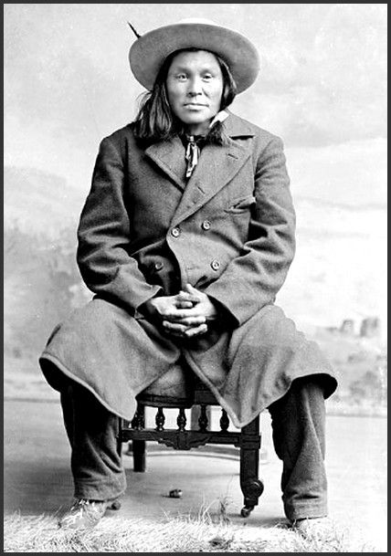 "Blackfoot man, Brocky or ""Tail Feather Coming Over the Hill"" in partial native regalia. Photographed: December 29, 1891."