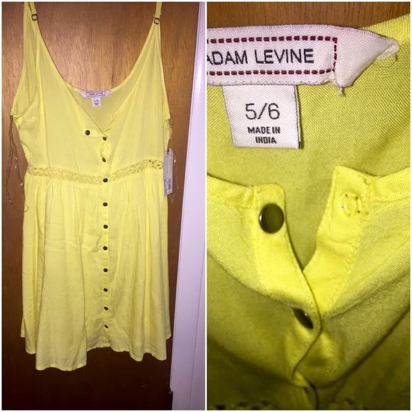NWT Adam Levine sundress. Adorable bright yellow sundress. Never worn. 32 inches in length  from top strap. About 22.5 in length measured inseam from arm hole. Tags attached. The once snap from the top came detached. But, still attached to front snap. Could be easily fixed.size says 5/6 but I typically wear women's small or 4 and fits like a women's small/4 Adam levine Dresses Mini