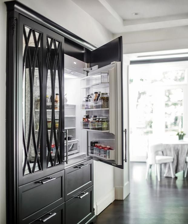 This Kitchen Really Stands Out With A Black Refrigerator