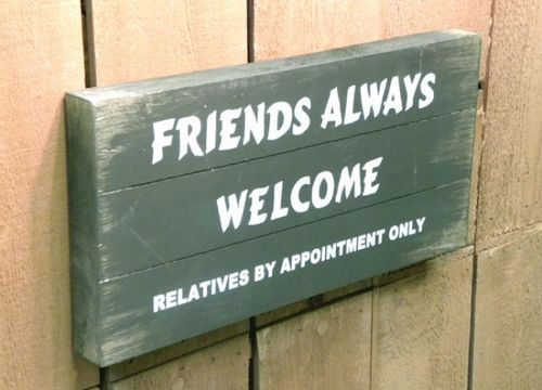 This humorous wooden pallet sign reads \