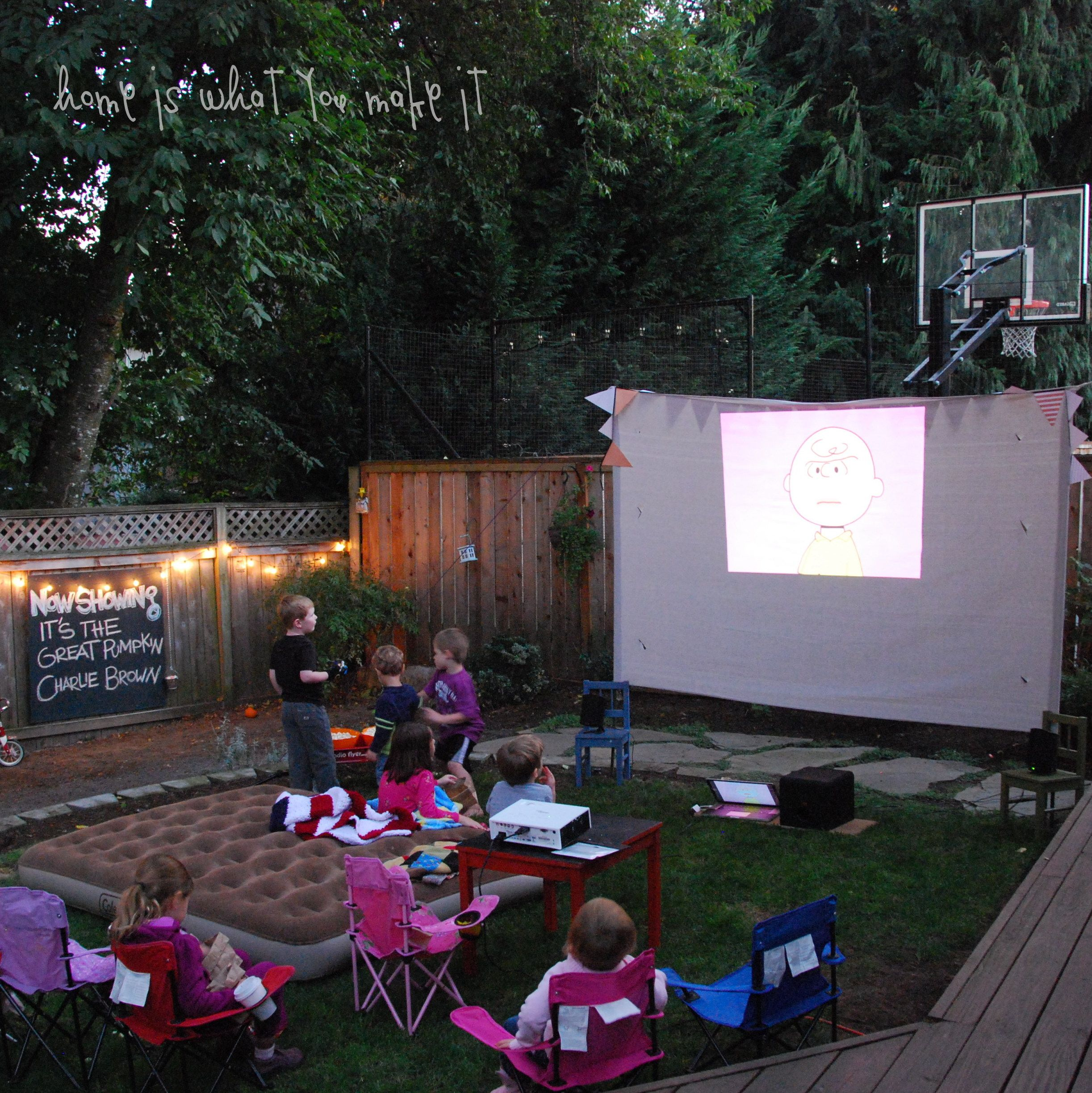 watching movies on an outdoor screen is so fun it takes a bit of