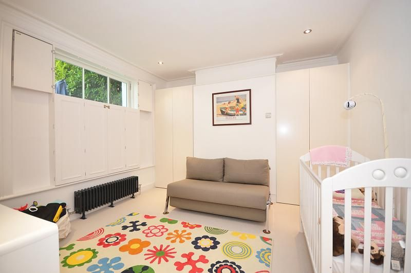 Chiswick High Road, W4 Gunnersbury. Cheerful rug is the focal point in this nursery.