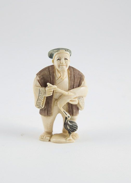 Signed Ivory Netsuke of a standing artist with brush & palette