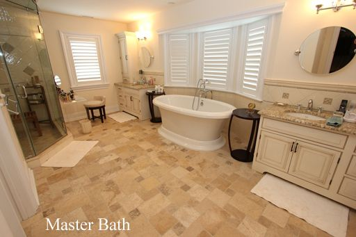 Master bath with granite tops, designer tile, steam shower with body ...