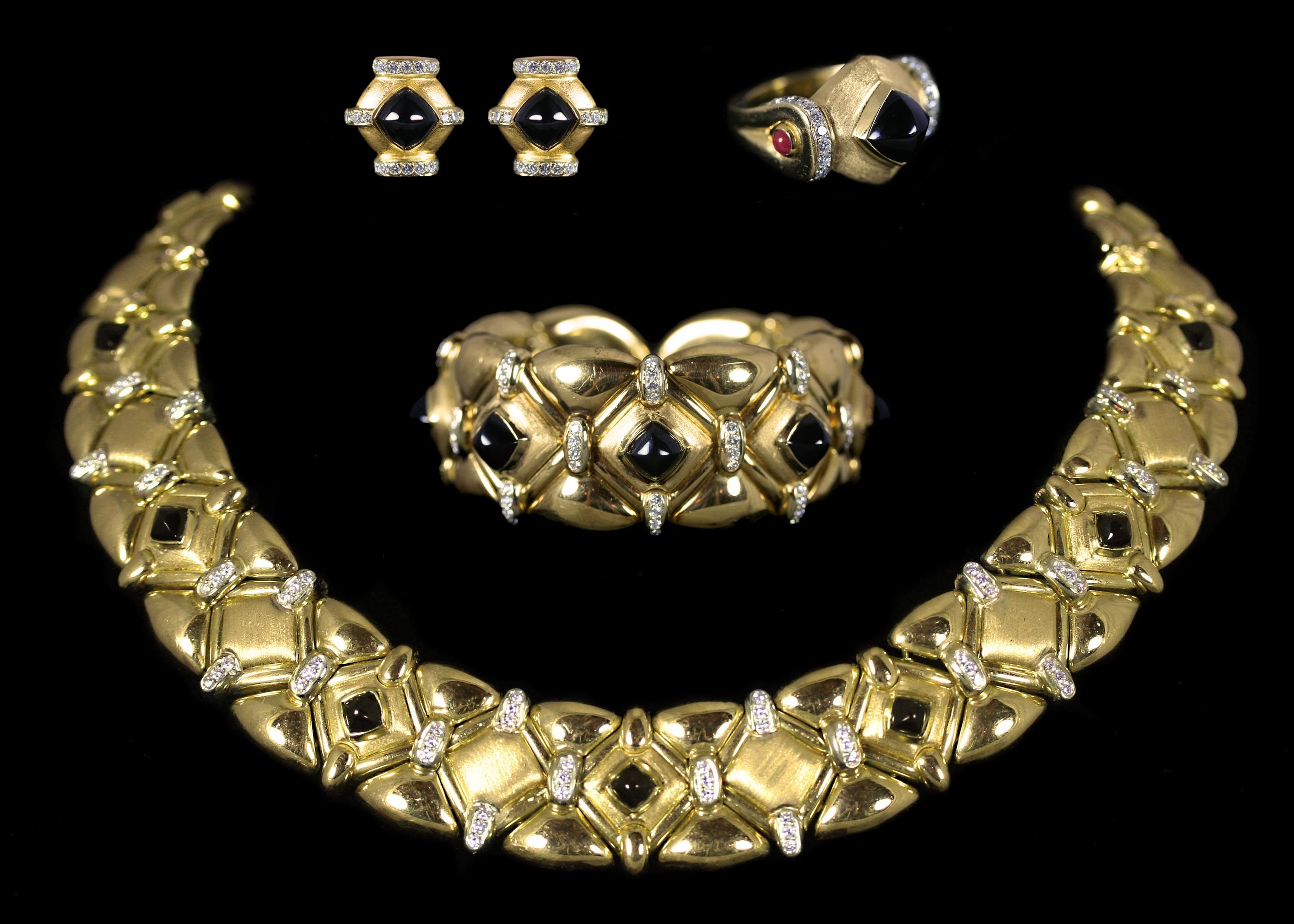 Black Onyx Set. This set comes with a necklace, earrings, ring, and a bracelet. This set has a total of approximately 7.00 carats of Diamonds and Black Onyx. All the pieces are set in 18 karat Yellow Gold.