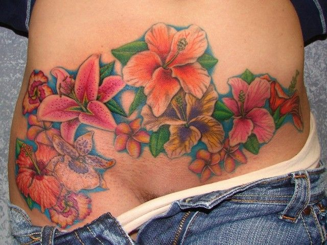 Stomach tattoos to cover stretch marks tattoospedia for Tattoos to cover scars on stomach
