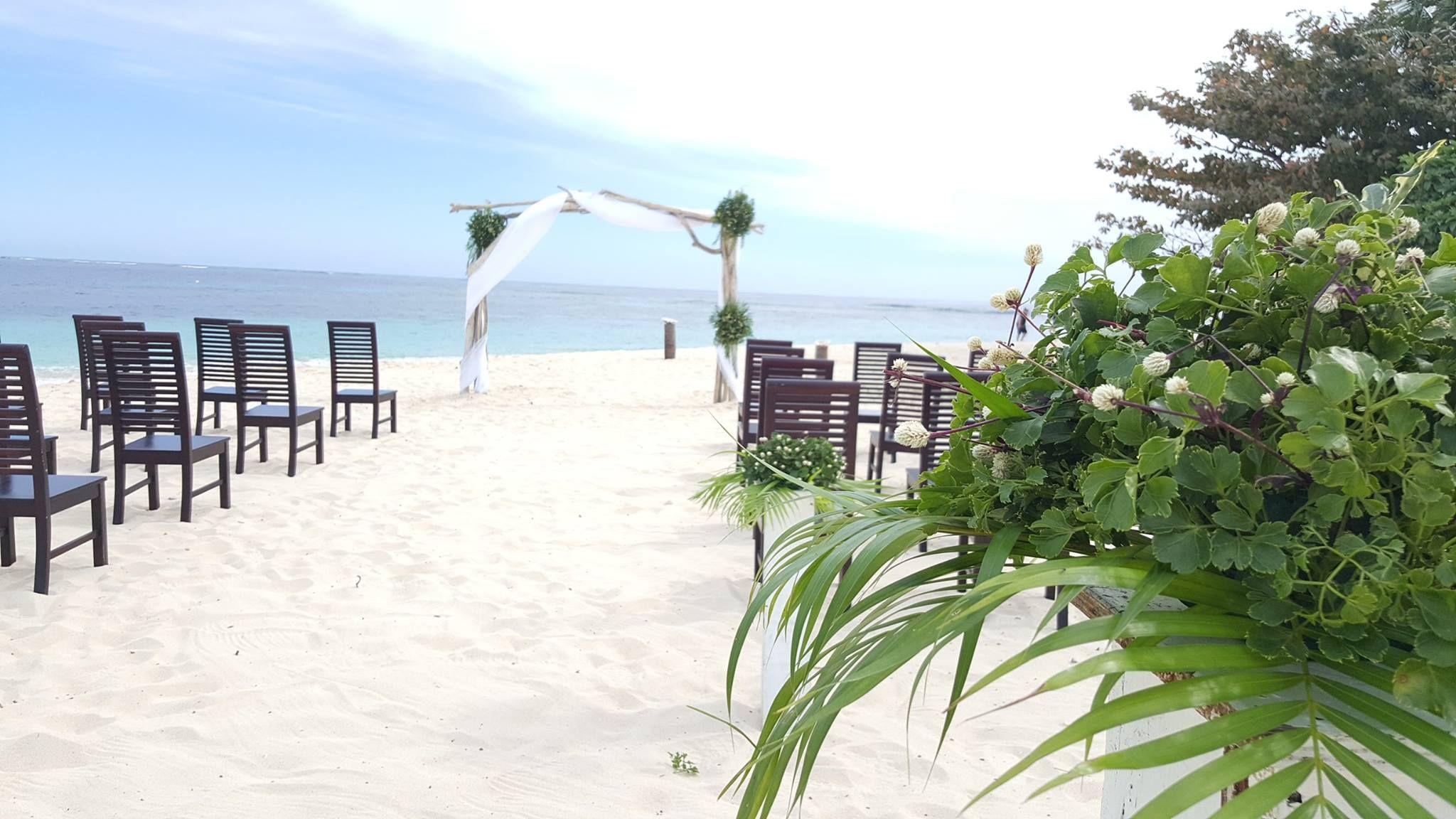 A sunset beach wedding at Matamanoa Island Resort Fiji