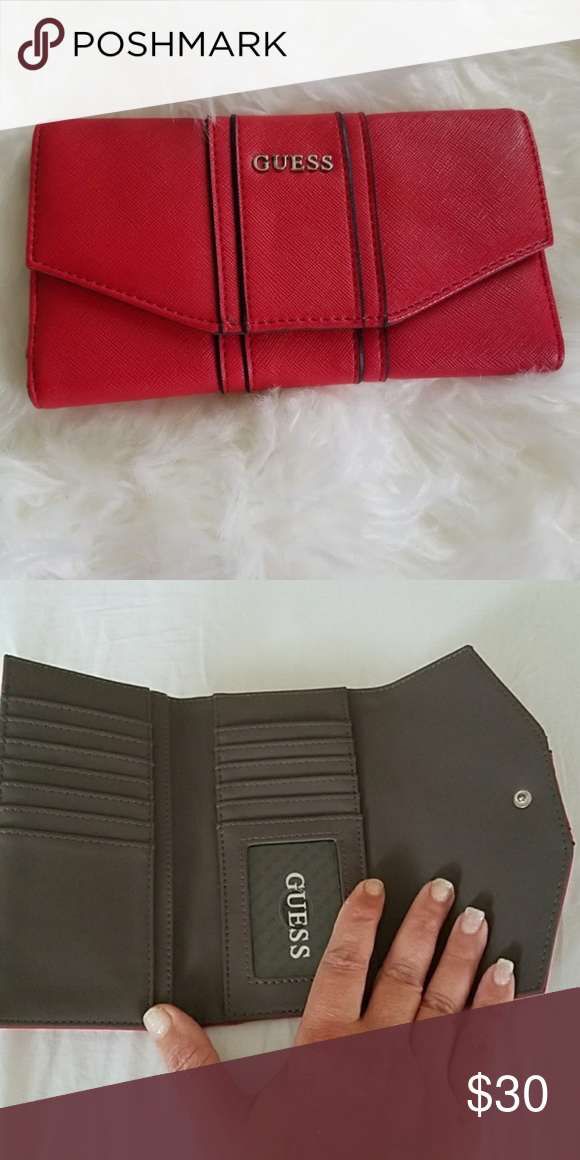 aac008d6de9 Authentic Guess Wallet Perfect Condition!!!! Red Authentic Guess wallet.  Perfect size--hold 14 cards and a ID sleeve. Features an outside zipper on  back.