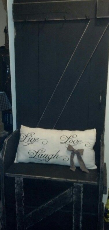 Old door turned into bench with storage underneath the bench, hooks on door to hang things & a primitive pilllow