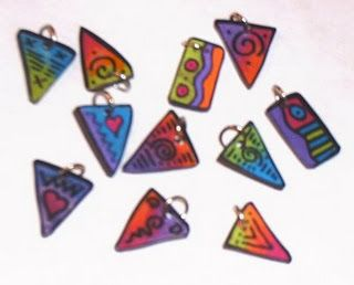 Charms; made out of shrink plastic, and colored with permanent black sharpie and colored pencils