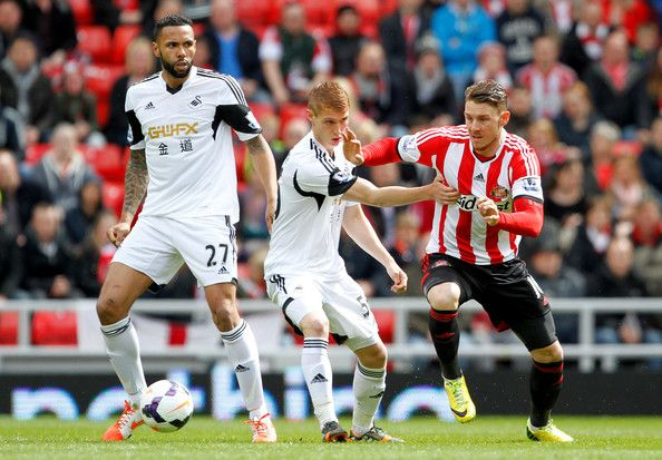 Connor Wickham of Sunderland and Jay Fulton iof Swansea City battle for the ball during the Barclays Premier League match between Sunderland...