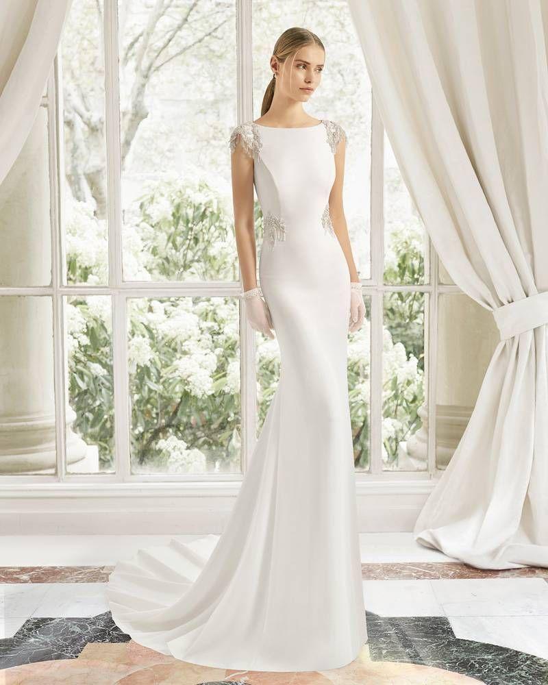 Viento fuerte Abultar Contratar  Un vestido de novia sencillo con los adornos justos y adecuados. Un vestido  de novia…   Vestidos de novia sencillos, Vestidos de novia, Vestidos de  novia con mangas