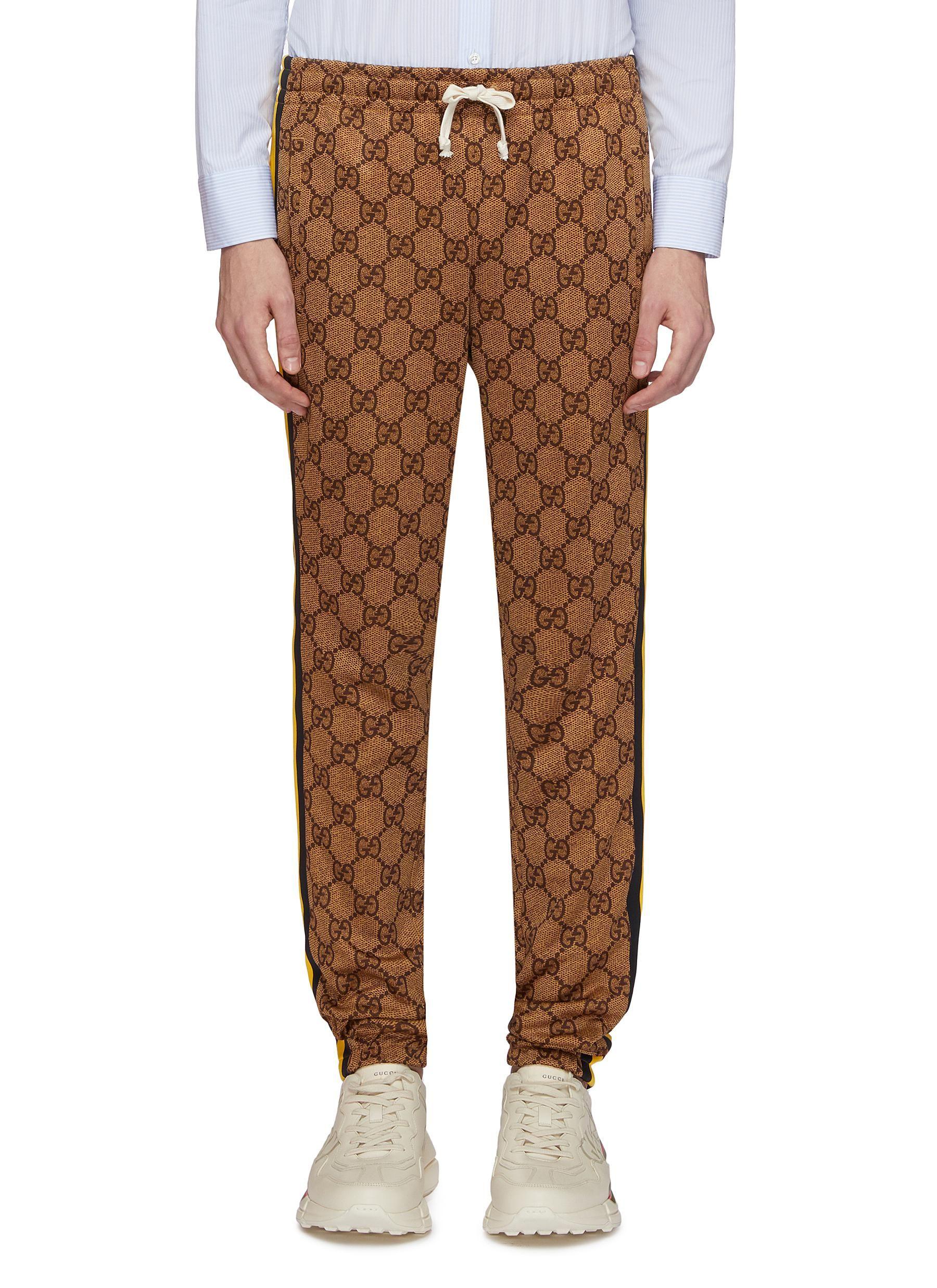 GUCCI Stripe outseam GG logo intarsia jogging pants.