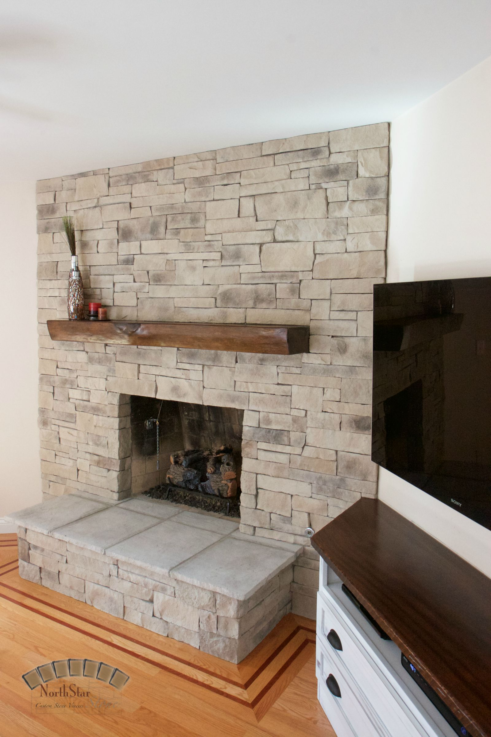 This style of stone is our Old Ledge Stone Veneer. The beam/mantel ...