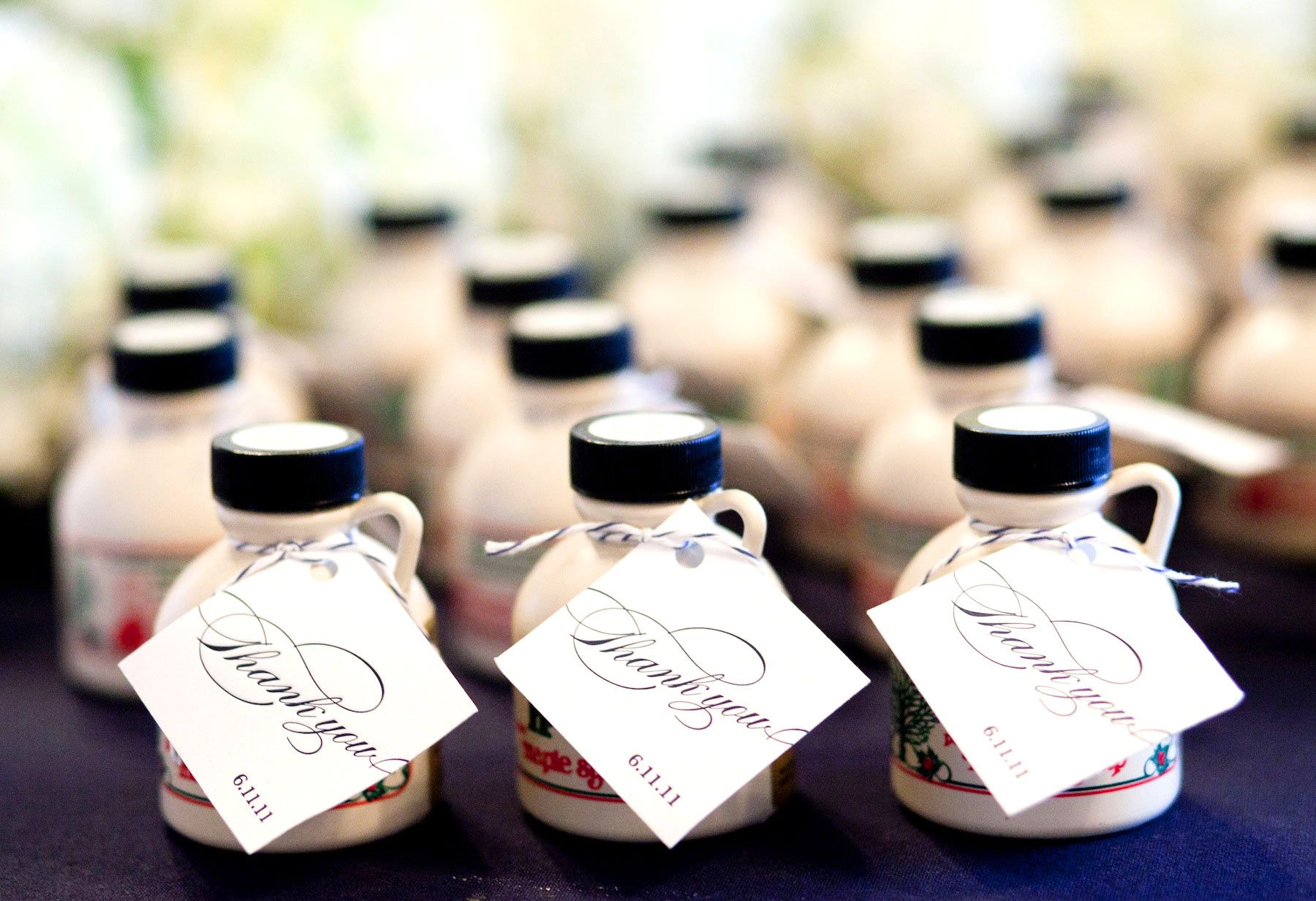 Favors- Mini jugs of maple syrup... because we met at ihop :) Also ...