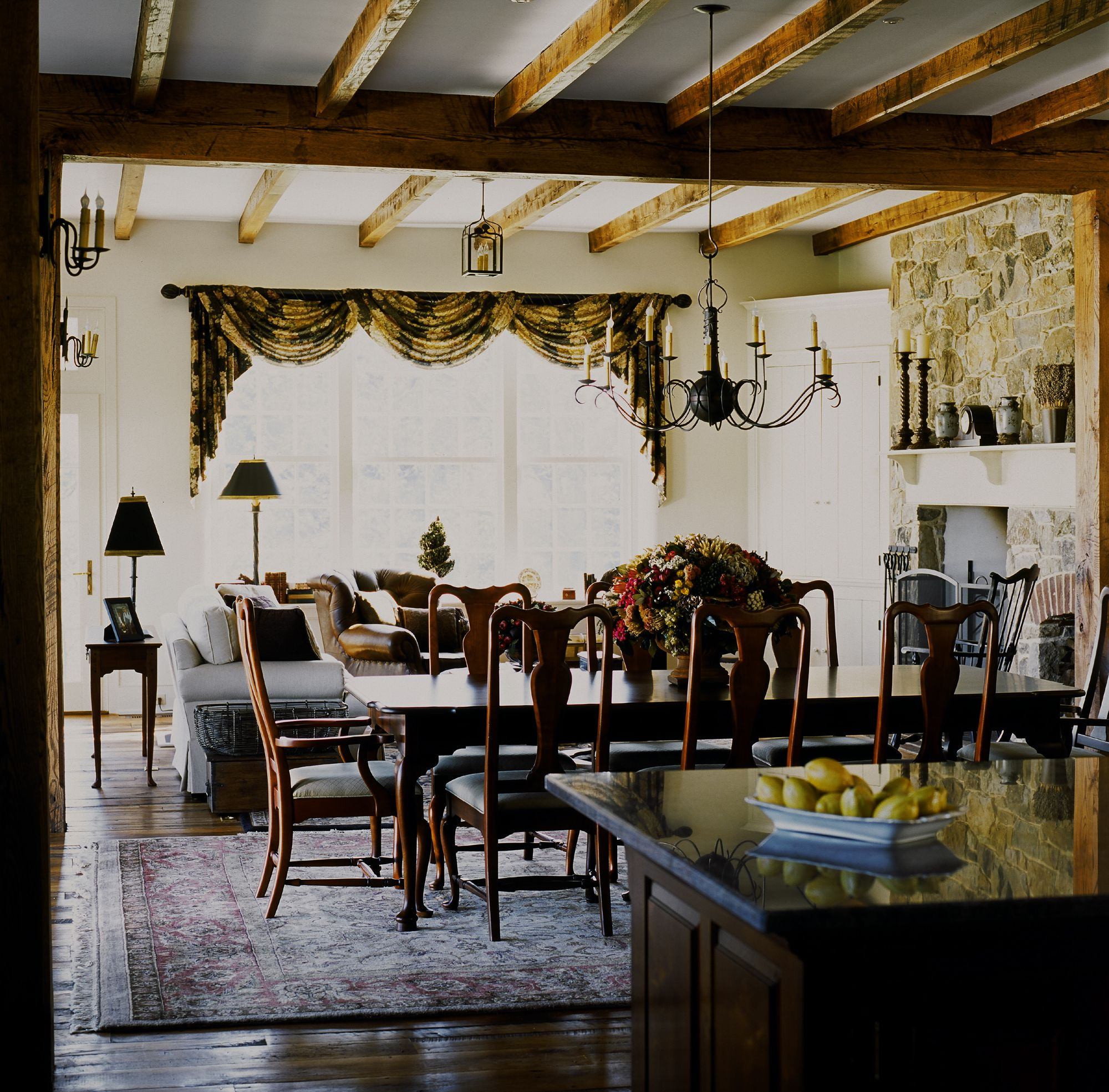 Tis dining area separates the kitchen from a family ...