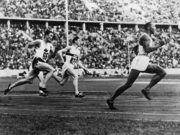 Aug. 9, 1936 - At the Berlin Olympics, African American track star Jesse Owens wins his fourth gold medal of the Games in the 4x100-meter relay. His relay team set a new world record of 39.8 seconds, which held for 20 years.