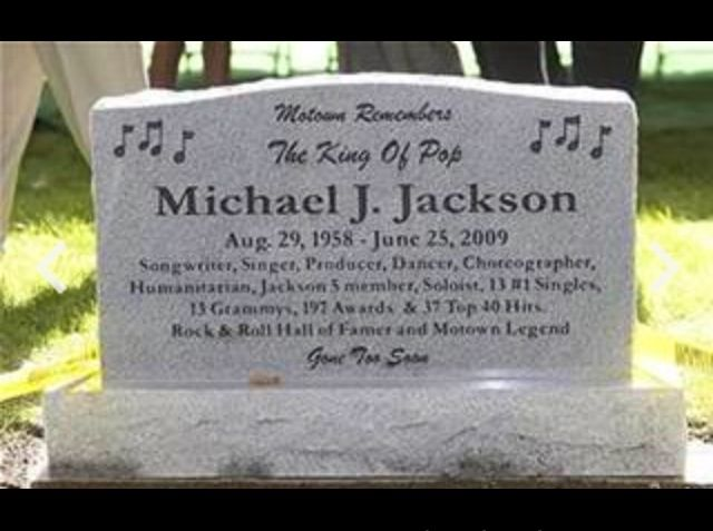 Michael Jackson's tombstone: Music notes on both sides at the top left and  top right