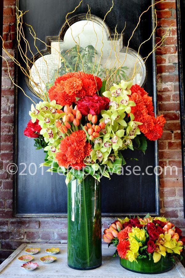 Green orchids, orange dahlias, orange tulips. Flower