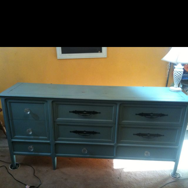 Painted and used some of the original knobs and painted them black! I loved this dresser!