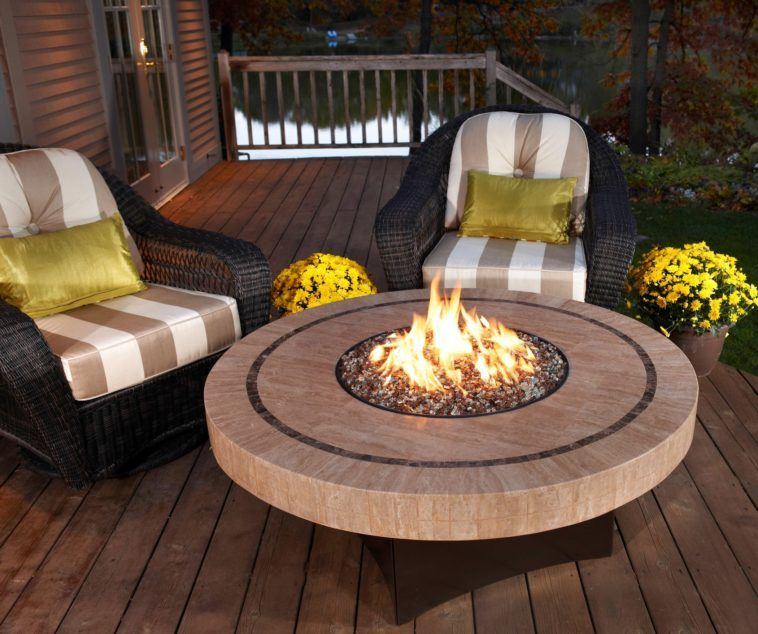 Back Yard Patio With Round Stone Gas Fire Pit Table Plus Black Wicker Chair Placed On Wooden Deck Natural Coffee Outdoor