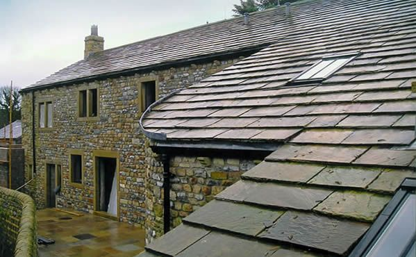 Nasmara Style Cobbled Buildings With Slate Roofs While Currently Most On The Farm Have Green Tinged Slate Illiandi Has Intent Slate Roof Roofing Roof Repair
