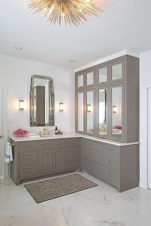 Gray Master Bathroom Is Filled With Vanity Cabinets Adorned Br Pulls Topped Mirrored