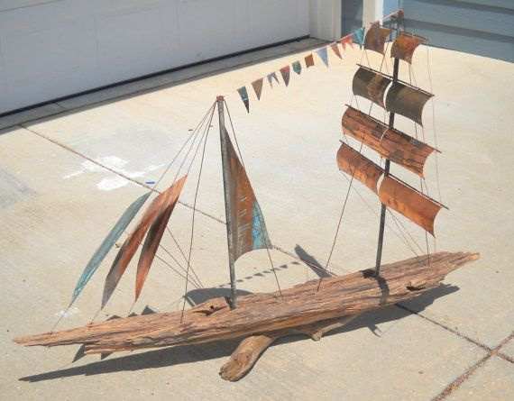 "Clipper Ship made of driftwood and recycled copper sails. This is a great center piece for a sofa table or put on your fireplace hearth.  Size: L58"" W23"" H36"""
