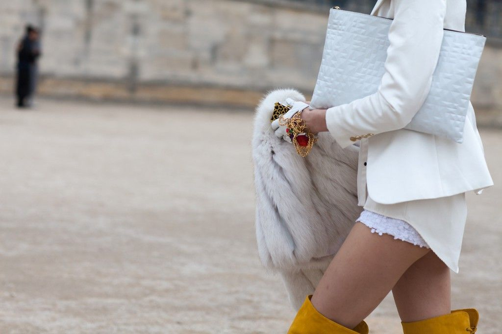 Thigh high boots paired with winter white & fur coat