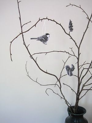 A paper decoration for bare indoor branches