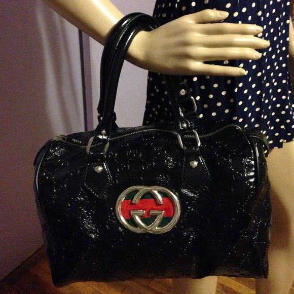 Handbag (Not Real never used its 10 inches tall and 11 inches wide the zipper inside works fine it has two pockets inside the outside zipper works fine Gucci Bags Mini Bags