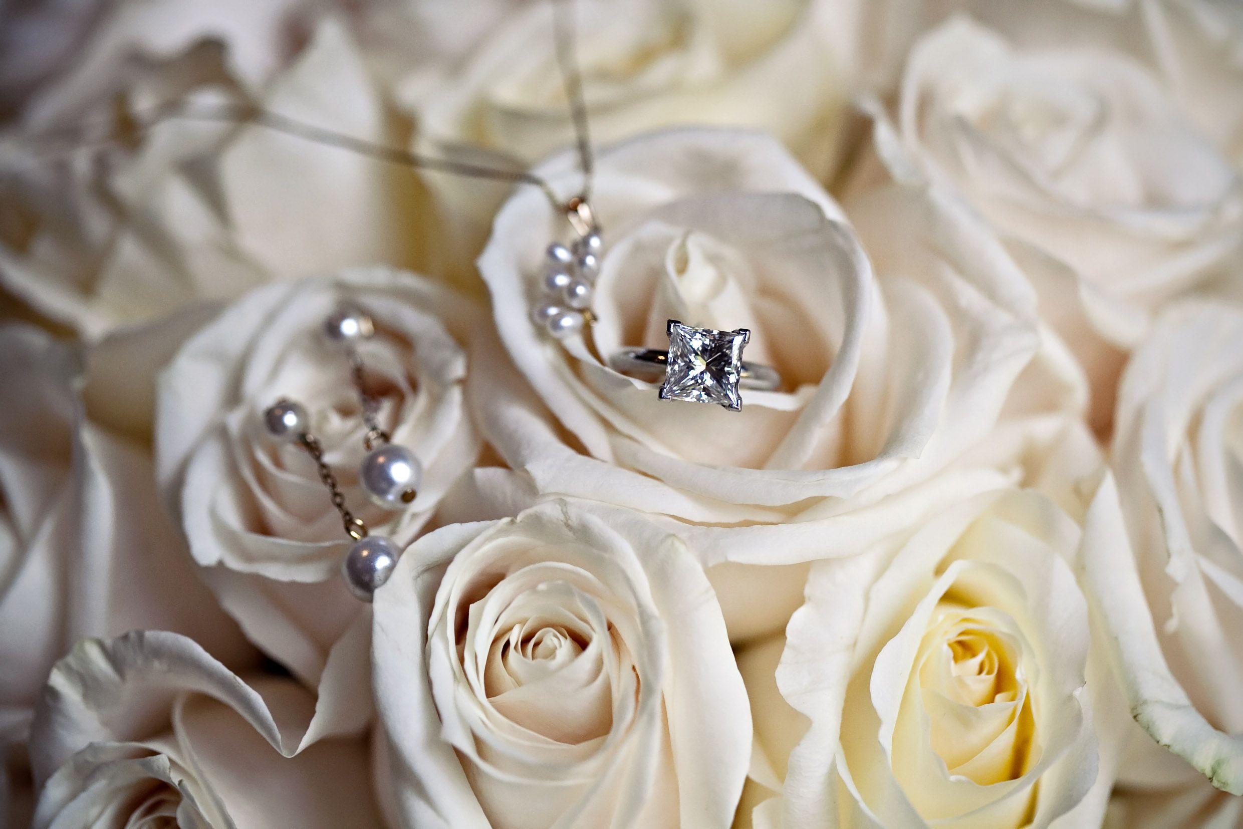 Wedding rings on white roses, simply elegant!