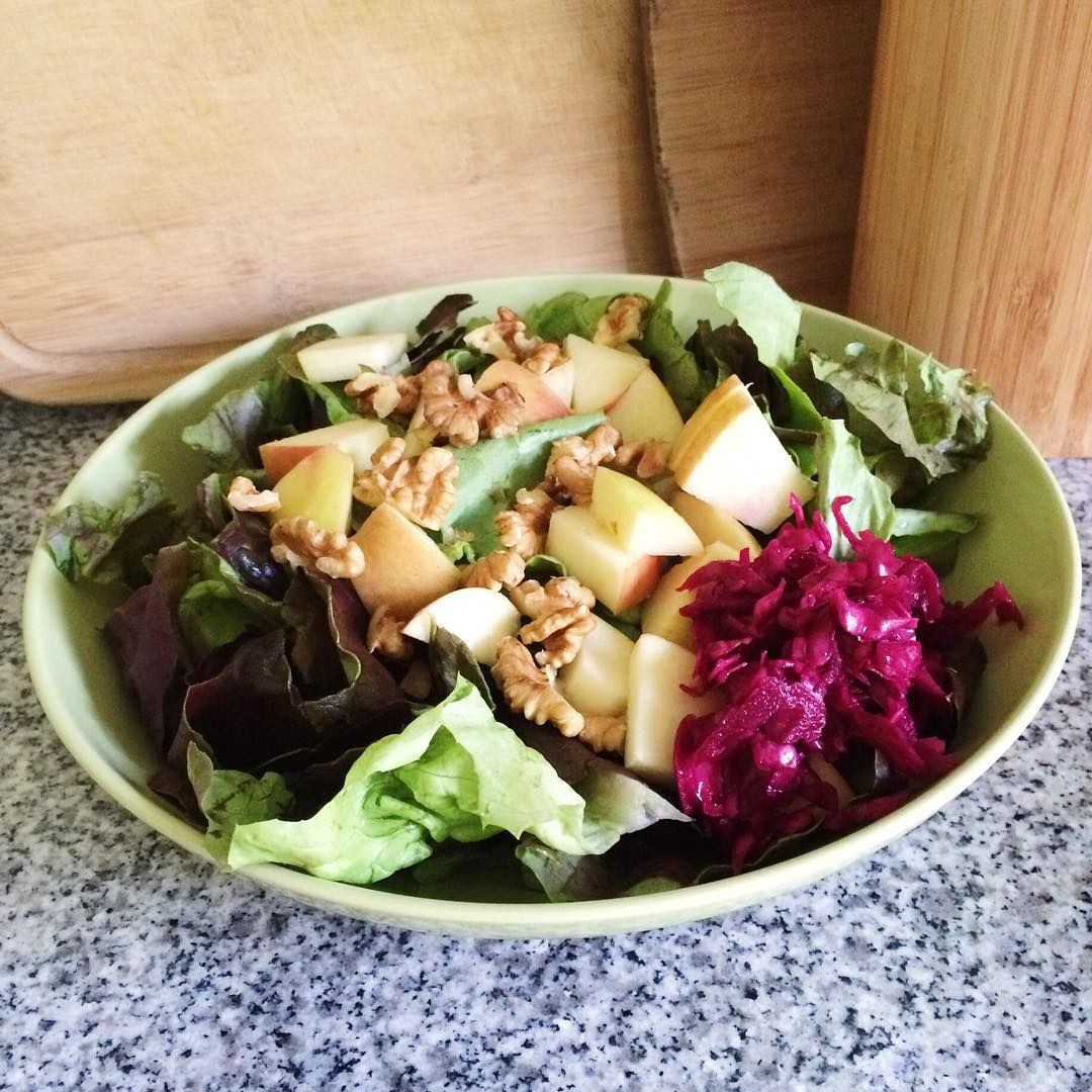 """Farmers market salad from lunch today. Lettuces, pink lady apple, walnuts, red cabbage sauerkraut. Simple and delicious. #whatveganseat #farmersmarket…"""