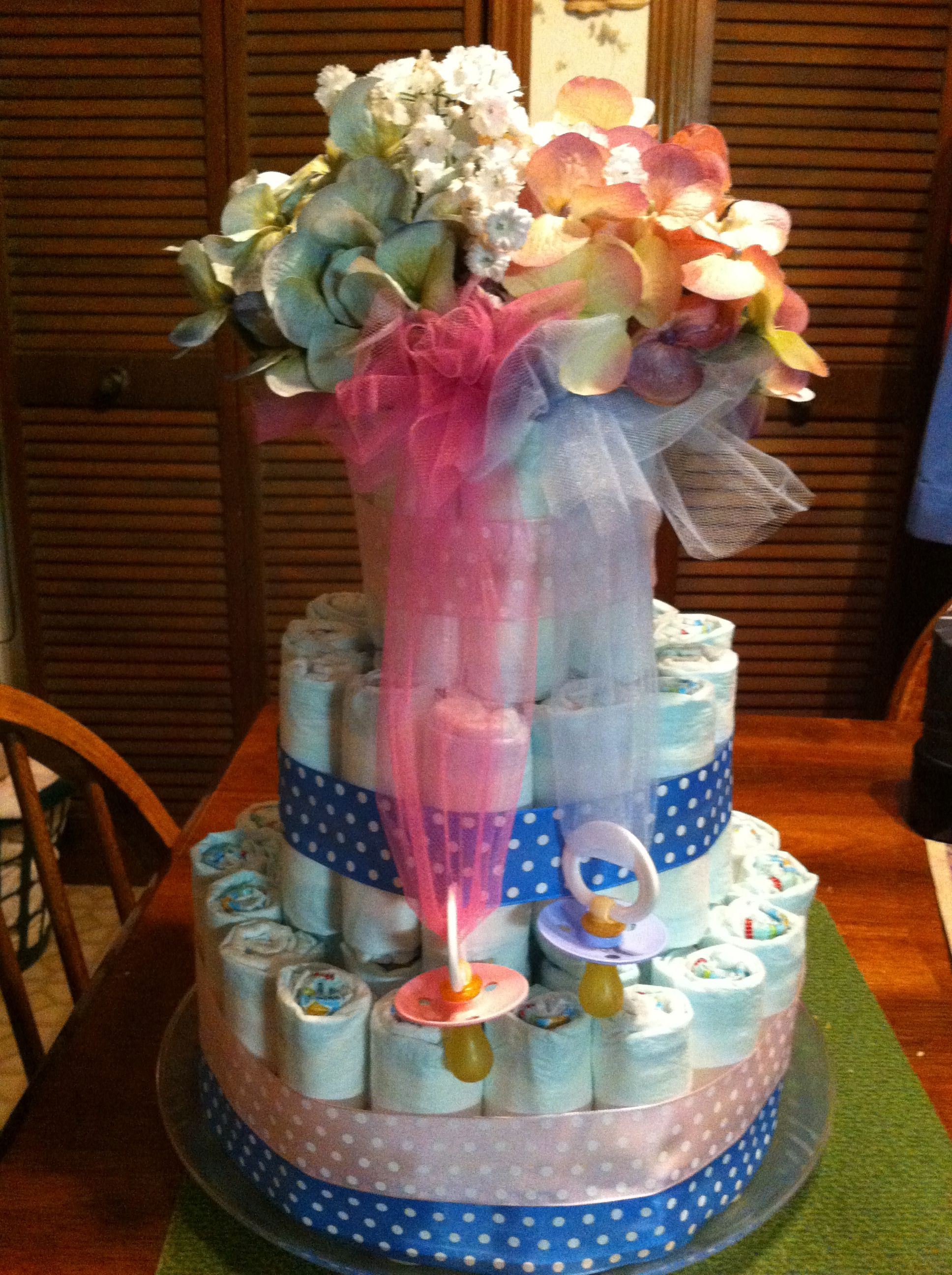 Diaper cake for a gender reveal party Baby shower