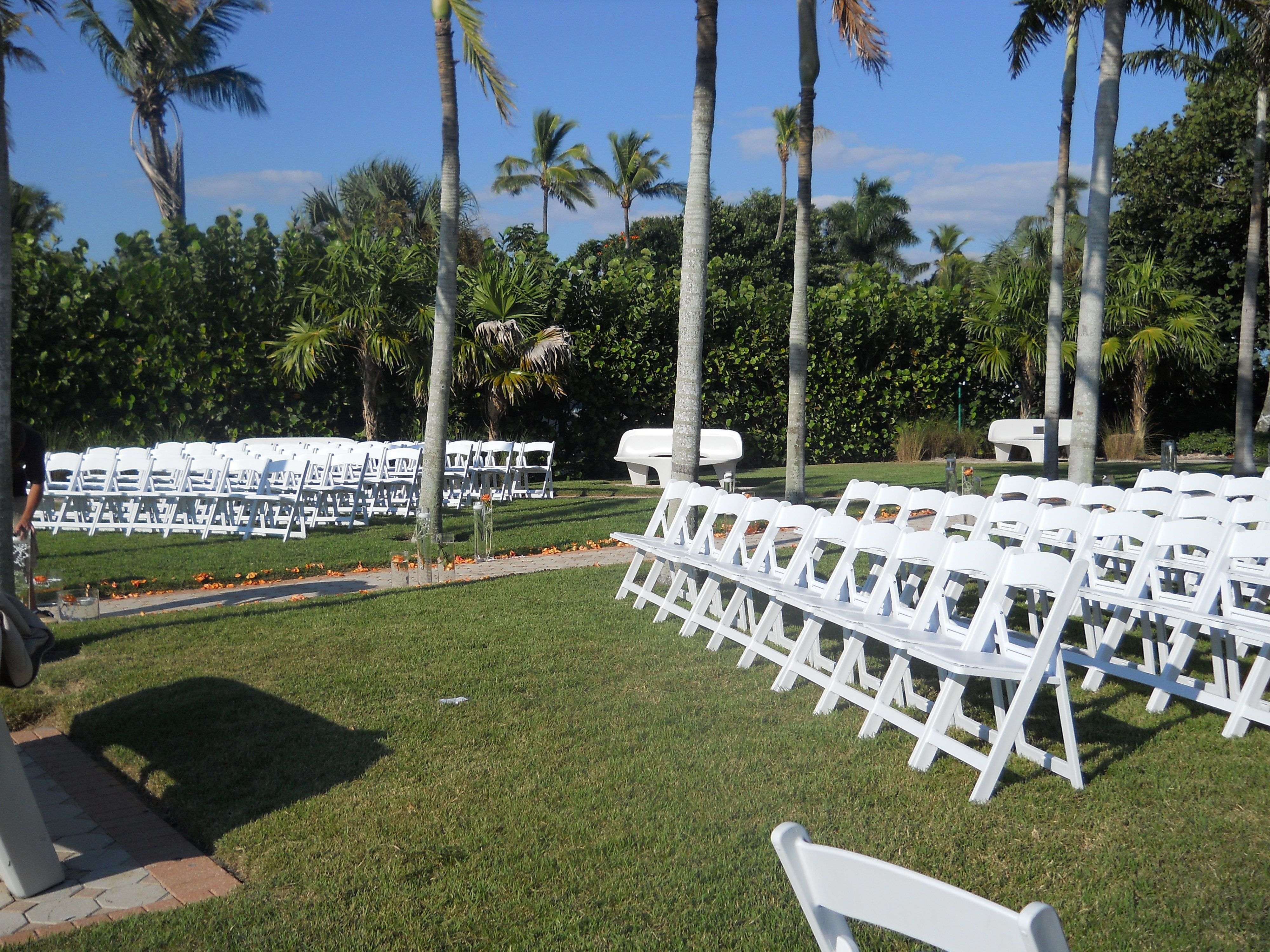 White folding chair rentals for 8th Ave South Naples wedding