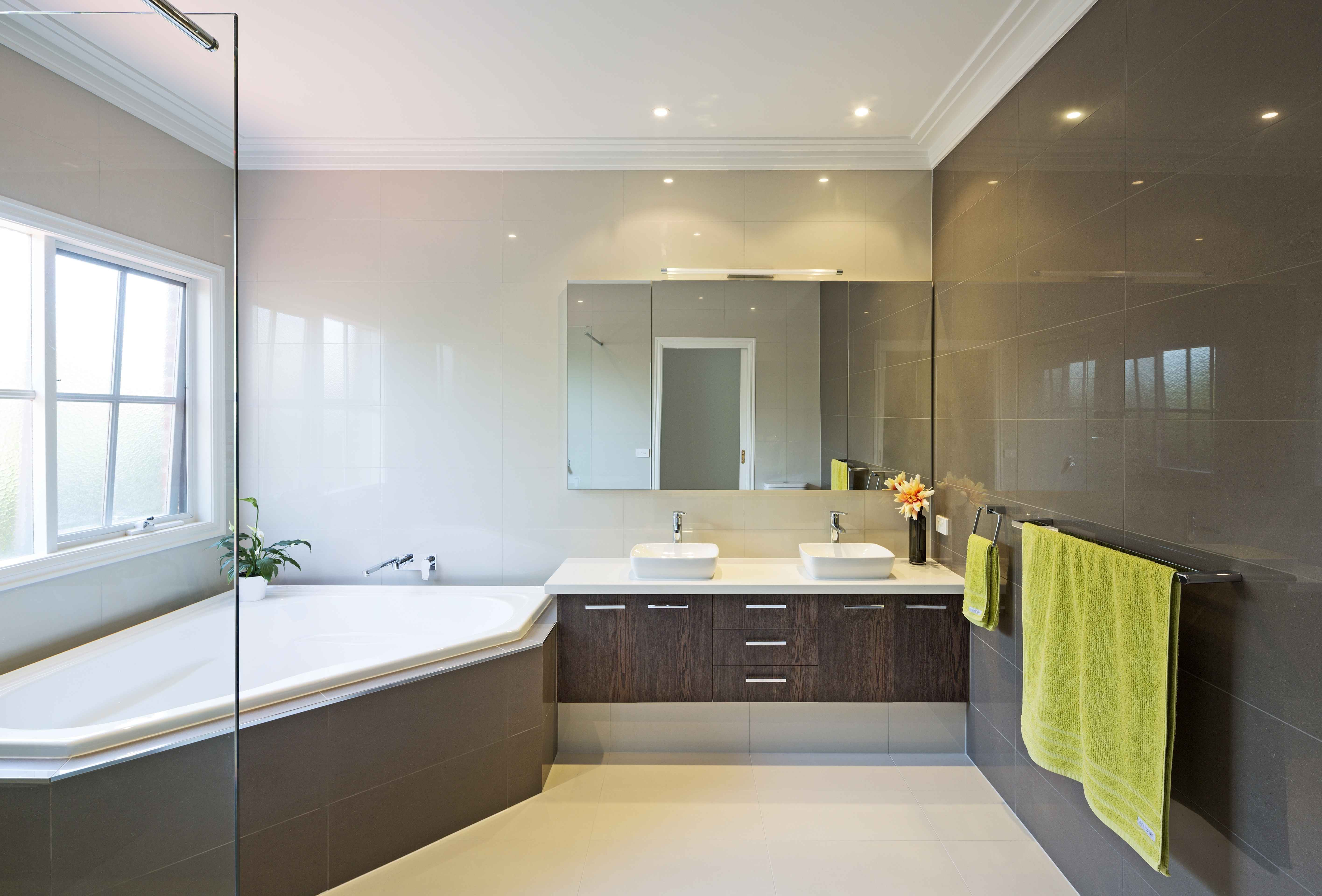 Corner spa bath, feature tiles and suspended vanity | Ultimate ...