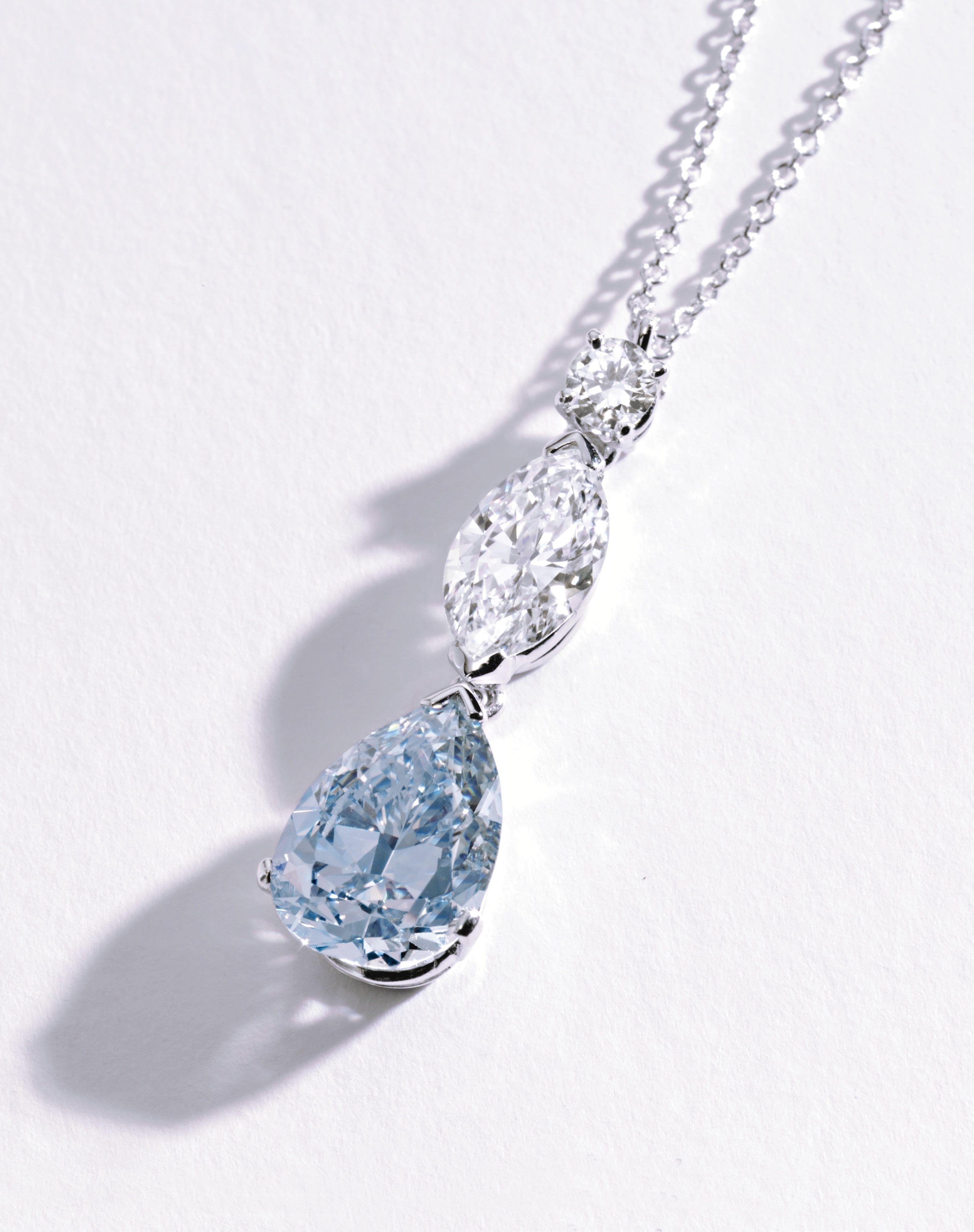PLATINUM FANCY INTENSE BLUE & NEAR COLORLESS DIAMOND PENDANT