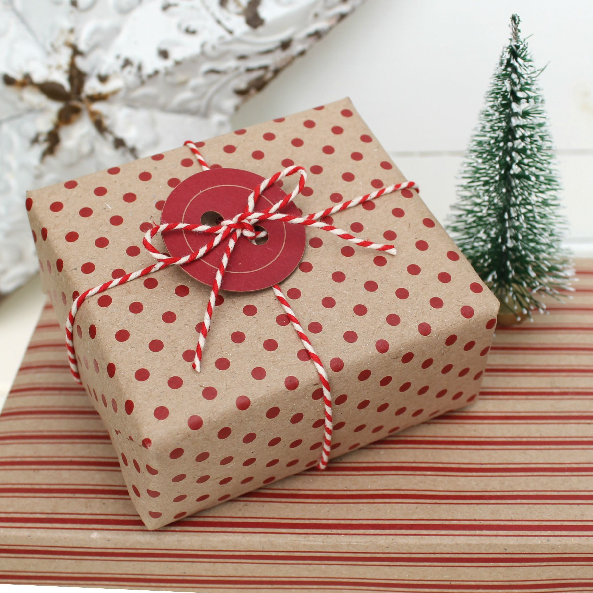 Christmas Kraft And Red Wrapping With Red Button Tag