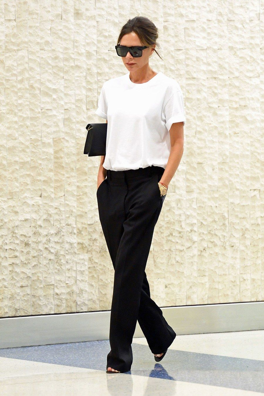 Victoria Beckham's Airport Style Ahead of Her Spring 2018 Show
