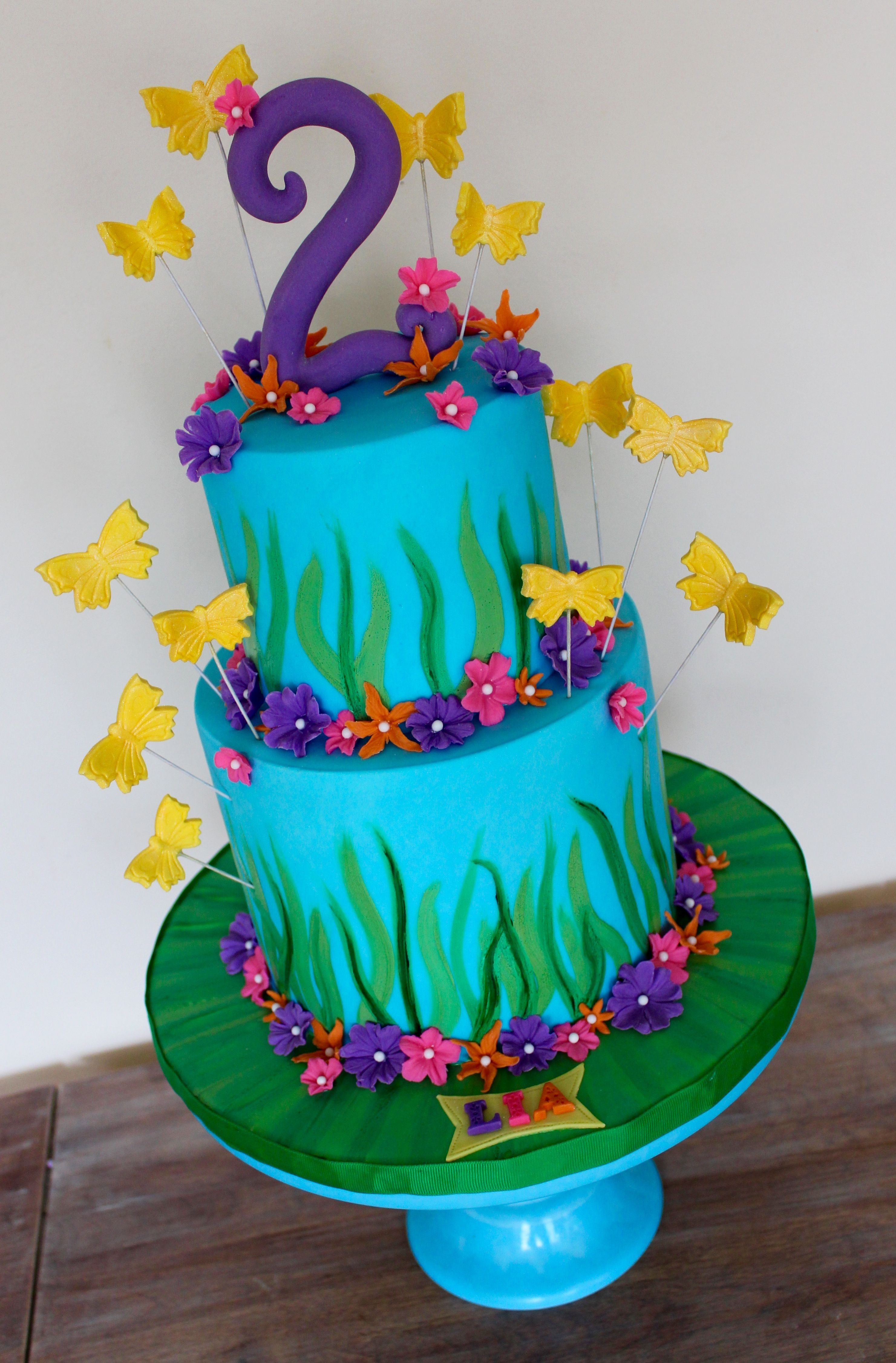 spring happy flowers colourful cake with butterflies and sugar flowers