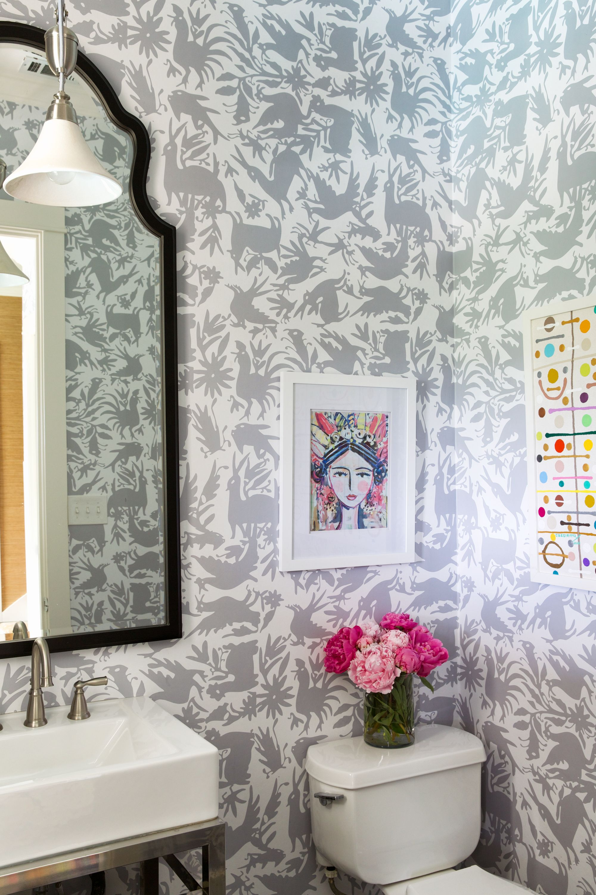 Grey Otomi wallpaper in a powder room. Print wallpaper