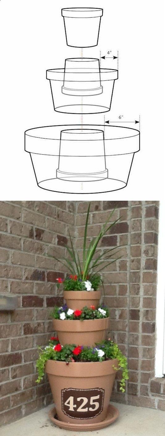 N ° 8. Créez un chef-dœuvre tout simplement en empilant des pots. - 13 Clever arrangement floral Trucs et astuces