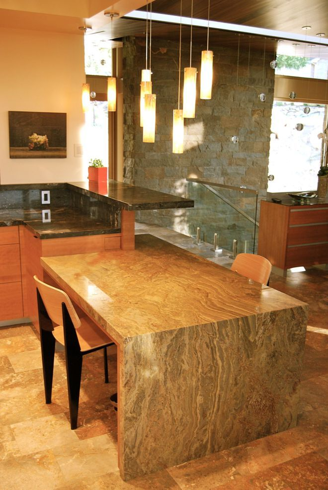 Kitchen Table With Stone Countertop With A Waterfall Edge