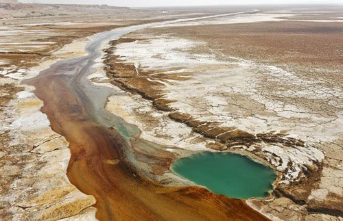 Hyper-saline waters seep out of the ground
