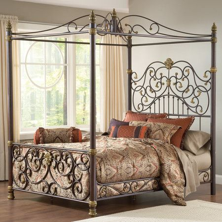 Metal Canopy Bed With An Ornate Scrolling Design Product Bed
